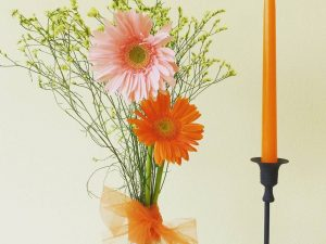 organge candel with flowers